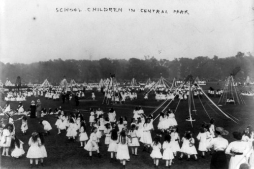 School children around May poles in Central Park, New York